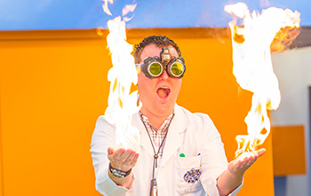 Mad scientist with fire in both hands